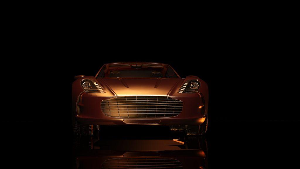 Na czarnym tle jasno brązowy samochód nieznanej marki.
